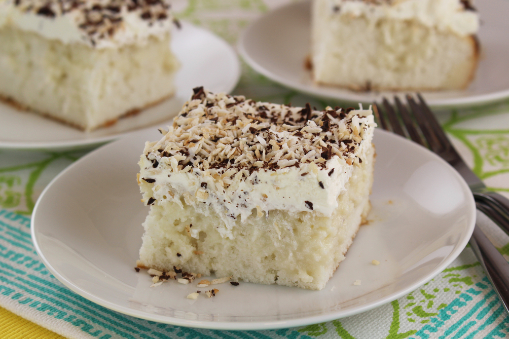 Coconut Poke Cake with Toasted Coconut & Chocolate